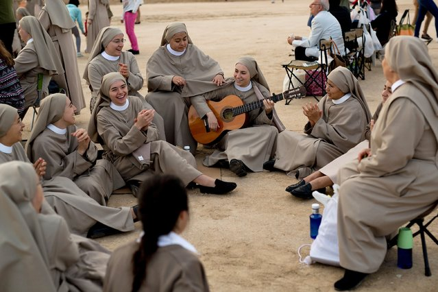 Nuns play music as they wait for the start of the beatification ceremony for Opus Dei former leader Alvaro del Portillo on September 27, 2014 in Madrid, Spain. (Photo by Pablo Blazquez Dominguez/Getty Images)