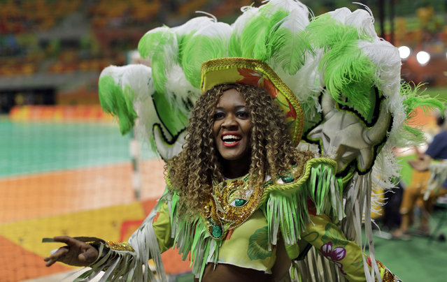 A dancing band parades around the arena before the men's finals handball match between Denmark and France at the 2016 Summer Olympics in Rio de Janeiro, Brazil, Sunday, August 21, 2016. (Photo by Ben Curtis/AP Photo)
