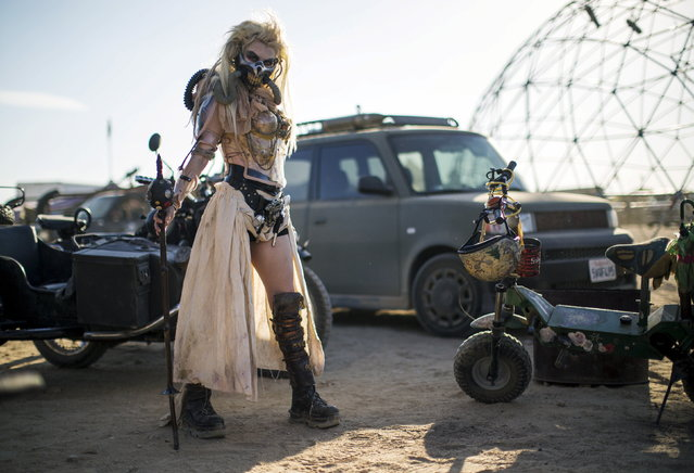 "Enthusiast Desirae Hepp, dressed as ""Immortan Joe,"" poses for a portrait during Wasteland Weekend event in California City, California September 26, 2015. The four-day event has a post-apocalyptic theme and is inspired by the Mad Max movie franchise. (Photo by Mario Anzuoni/Reuters)"