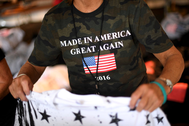 """Sandy Caruthers wears a t-shirt stating """"Made In America Great Again"""", while selling merchandise during the fifth annual Made in America Music Festival in Philadelphia, Pennsylvania September 3, 2016. (Photo by Mark Makela/Reuters)"""