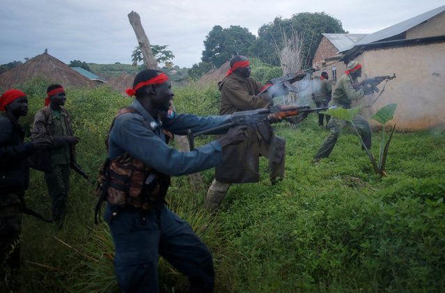 SPLA-IO (SPLA-In Opposition) rebels fire weapons during an assault on government SPLA (Sudan People's Liberation Army) soldiers in the town of Kaya, on the border with Uganda, South Sudan, August 26, 2017. (Photo by Goran Tomasevic/Reuters)