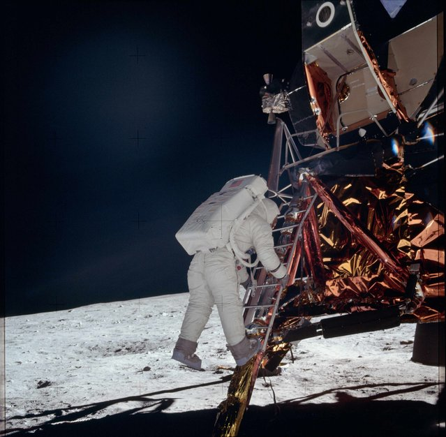 Astronaut Edwin E. Aldrin Jr., lunar module pilot, descends the steps of the Lunar Module (LM) ladder as he prepares to walk on the moon during the Apollo 11 mission in this July 20, 1969 NASA handout photo. (Photo by Reuters/NASA)