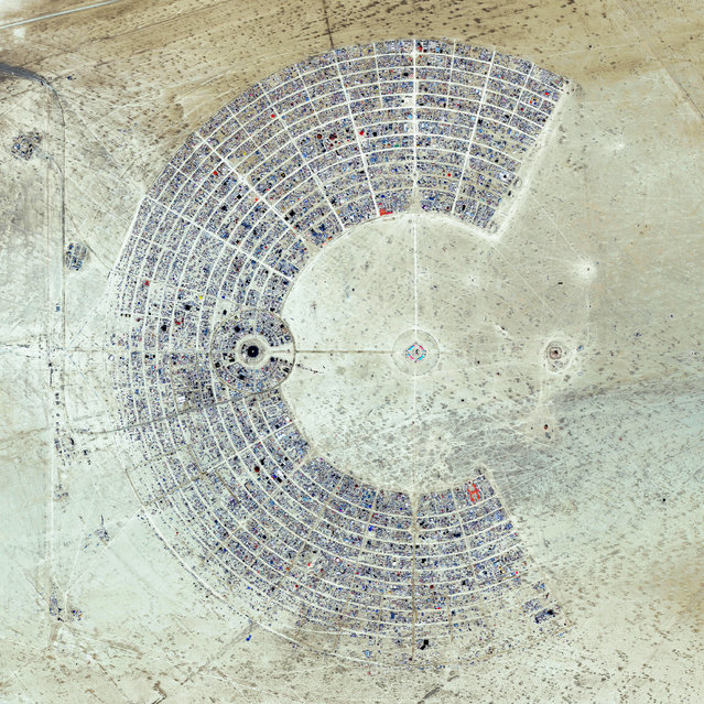 Burning Man is a week-long, annual event held in the Black Rock Desert of Nevada, USA. Drawing more than 65,000 participants each year, the event is described as an experiment in community, art, self-expression, and radical self-reliance. (Photo by Benjamin Grant/Penguin Random House)