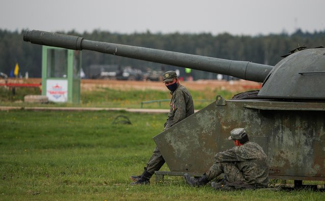 Russian servicemen rest during the Tank Biathlon competition at the International Army Games 2020 in Alabino, outside Moscow, Russia September 2, 2020. (Photo by Maxim Shemetov/Reuters)
