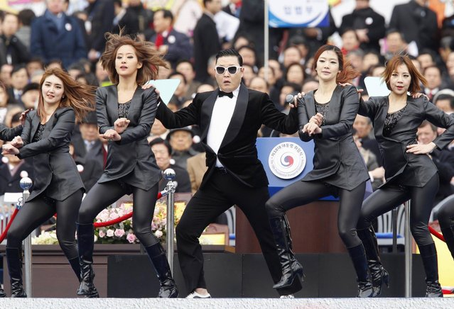 """Singer Psy (C) performs during the inauguration ceremony of South Korea's new President Park Geun-Hye at parliament in Seoul, February 25, 2013. Park Geun-Hye became South Korea's first female president on February 25, vowing zero tolerance with North Korean provocation and demanding Pyongyang """"abandon its nuclear ambitions"""" immediately. (Photo by Kim Hong-Ji/AFP Photo)"""