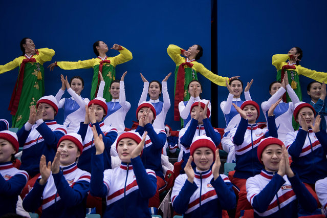 North Korean cheerleaders perform for a women' s preliminary round ice hockey match between Unified Korea and Japan during the Pyeongchang 2018 Winter Olympic Games at the Kwandong Hockey Centre in Gangneung, South Korea on February 14, 2018. (Photo by Brendan Smialowski//AFP Photo)