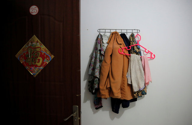 Clothes hang in a room where Huang and her husband Pan stay at the accommodation where some patients and their family members stay while seeking medical treatments in Beijing, China, June 22, 2016. (Photo by Kim Kyung-Hoon/Reuters)
