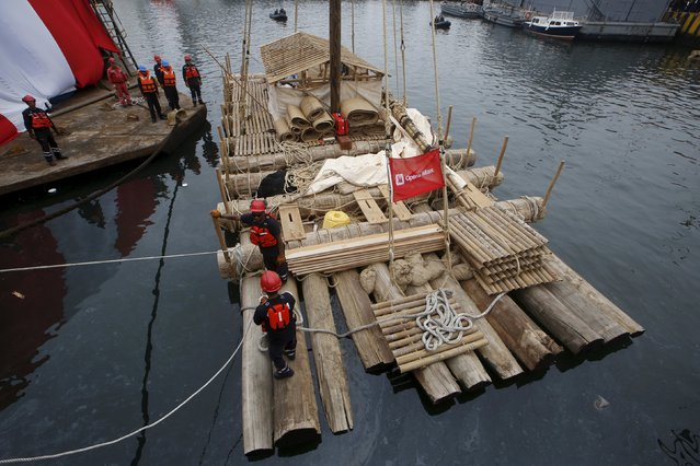 One of the two wooden rafts of the Kon-Tiki II expedition is prepared  at the port of Callao prior to the departure to Pascua island in Chile, in Callao, Peru, October 30, 2015. Fourteen men from various parts of the world set out on rafts to commemorate the  Norwegian navigator Thor Heyerdahl expedition 68 years ago. (Photo by Mariana Bazo/Reuters)