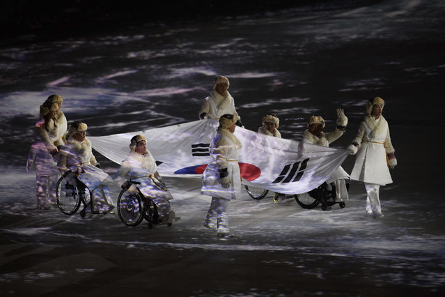 Flag bearers enter with the South Korean flag during the Opening Ceremony for the XII Paralympic Winter Games in the Pyeongchang Olympic Stadium, Pyeongchang, South Korea, Friday, March, 9, 2018. (Photo by Joel Marklund/OIS/IOC via AP Photo)