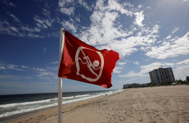 A red danger banner is seen on Pompano beach near Coral Springs while Hurricane Matthew approaches in Florida, U.S. October 5, 2016. (Photo by Henry Romero/Reuters)
