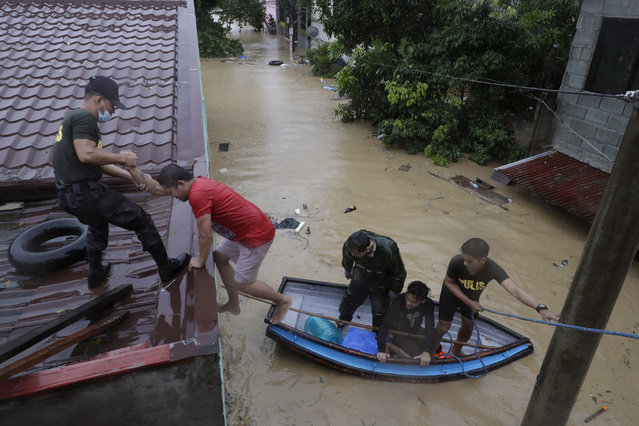 Police rescue residents as floods continue to rise in Marikina, Philippines, due to Typhoon Vamco Thursday, November 12, 2020. (Photo by Aaron Favila/AP Photo)