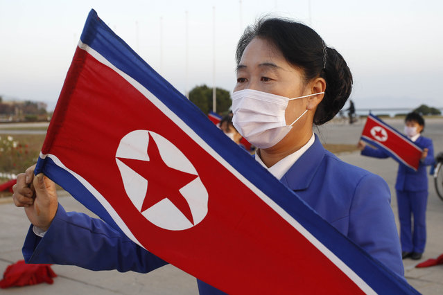 Wearing face masks members of Women's Union in Wonsan city make agitation activities to encourage workers during the rush hour in front of Haean Plaza in the city of Wonsan, Kangwon Province, North Korea DPRK, on Wednesday, October 28, 2020. (Photo by Jon Chol Jin/AP Photo)