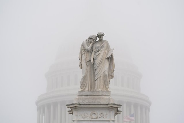 The Peace Monument, and the US Capitol behind it, is enshrouded in fog in Washington, DC, USA, 21 October 2020. Lawmakers are struggling to come up with another stimulus bill before the election. (Photo by Jim Lo Scalzo/EPA/EFE)