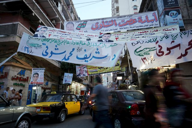 Electoral banners are seen on a street in Alexandria, Egypt, October 18, 2015. Egyptians turned out in low numbers on Sunday to vote in the first phase of an election hailed by President Abdel Fattah al-Sisi as a milestone on the road to democracy but shunned by critics who say the new chamber will rubber stamp his decisions. (Photo by Asmaa Waguih/Reuters)