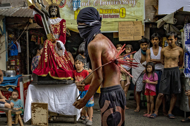 A flagellant whips his bloodied back along a street as penance, defying government orders to avoid religious gatherings and stay home to curb the spread of the coronavirus, as he commemorates Good Friday on April 10, 2020 in Manila, Philippines. Good Friday is a Christian holiday commemorating the crucifixion of Jesus and his death at Calvary. It is observed during Holy Week on the Friday preceding Easter Sunday. Most Easter celebrations in the Philippines have been cancelled after religious gatherings have been banned as part of government lockdown measures imposed on the country's main island Luzon to curb the spread of the coronavirus. Land, sea, and air travel has been suspended, while government work, schools, businesses, and public transportation have been ordered shut in a bid to keep some 55 million people at home. The Philippines' Department of Health has so far confirmed 4,076 cases of the new coronavirus in the country, with at least 203 recorded fatalities. The Philippines is the only Roman Catholic majority in Southeast Asia with around 85% practicing the faith. (Photo by Ezra Acayan/Getty Images)