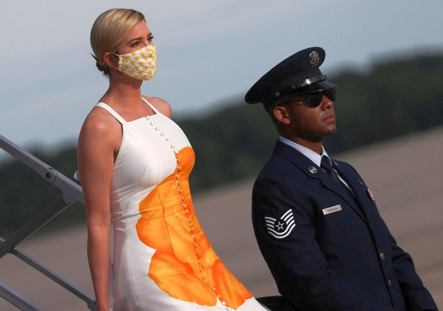 Ivanka Trump wears a protective face mask as she deplanes from Air Force One returning to Washington with her father U.S. President Donald Trump, after traveling to the Kennedy Space Center in Florida during the coronavirus disease (COVID-19) pandemic, at Joint Base Andrews, Maryland, U.S. May 27, 2020. (Photo by Jonathan Ernst/Reuters)
