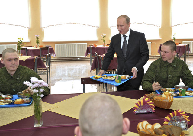 Vladimir Putin joins soldiers in their canteen during a visit to a military base in the Moscow region February 22, 2012. (Photo by Alexei Nikolsky/Reuters/RIA Novosti)