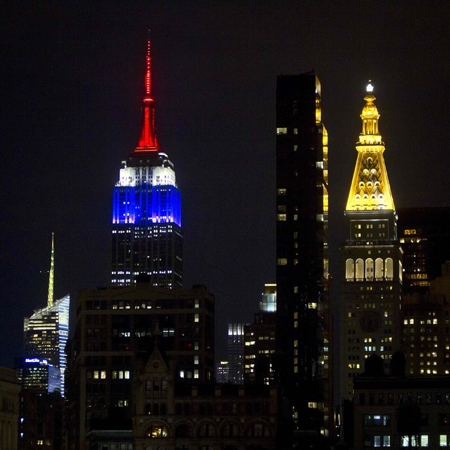 The Empire State Building is lit up in the colors of the French flag to pay tribute to the victims of the shooting by gunmen at the Paris offices of weekly satirical magazine Charlie Hebdo, in the Manhattan borough of New York January 11, 2015. (Photo by Carlo Allegri/Reuters)