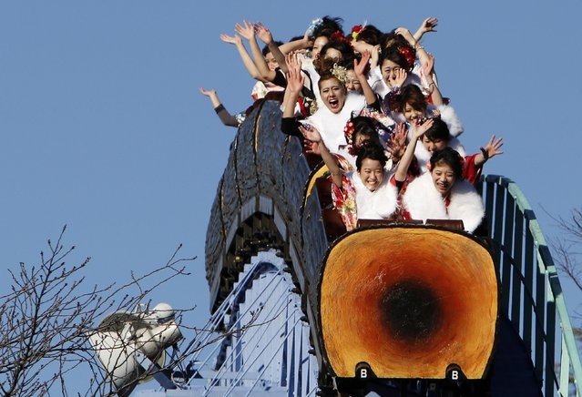 Twenty-year-old Japanese women wearing kimonos ride a roller coaster during their Coming of Age Day celebration at an amusement park in Tokyo January 12, 2015. (Photo by Yuya Shino/Reuters)