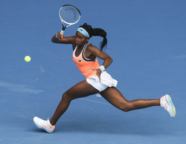 United States' Cori Gauff makes a forehand return to Switzerland's Jil Teichmann during a tuneup tournament ahead of the Australian Open tennis championships in Melbourne, Australia, Monday, February 1, 2021. (Photo by Hamish Blair/AP Photo)