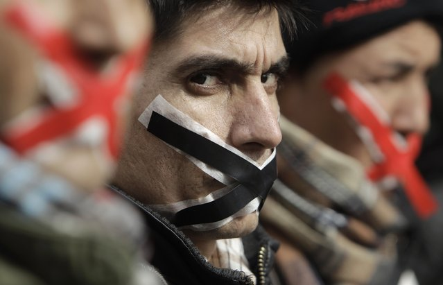 Immigrants and asylum seekers, with their mouths taped, protest to demand for asylum in central Athens in this February 1, 2011 file photo. (Photo by John Kolesidis/Reuters)