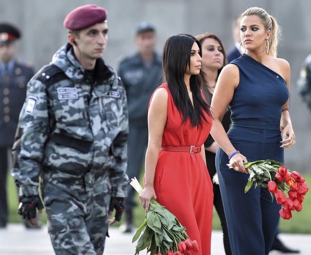 Kim Kardashian and her sister Khloe attend a flower laying ceremony at the Tsitsernakaberd Armenian Genocide Memorial Museum in Yerevan, Armenia, April 10, 2015. (Photo by Hayk Baghdasaryan/Reuters/Photolure)