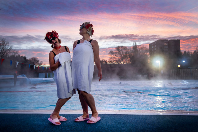 Swimmers known as the Lido Ladies pose by the pool during sunrise at Charlton Lido in Hornfair Park, London on December 2, 2020, on its first day of reopening after the second national lockdown ended and England enters a strengthened tiered system of regional coronavirus restrictions. (Photo by Victoria Jones/PA Images via Getty Images)