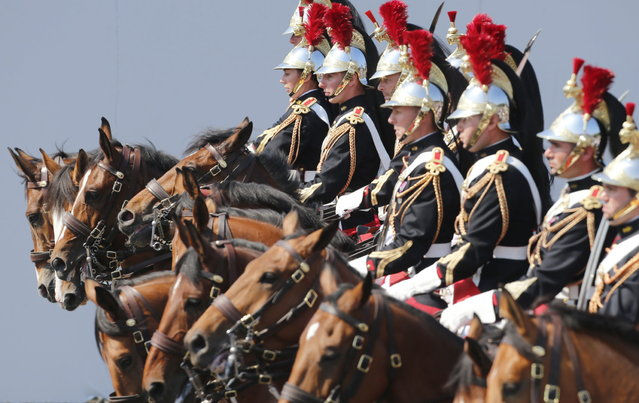 French Republican horse Guards parade during the Bastille Day in Paris Sunday, July 14, 2013. (Photo by Jacques Brinon/AP Photo)