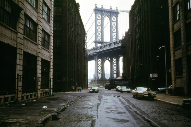 Manhattan Bridge tower in Brooklyn, New York City, framed through nearby buildings, in June of 1974.  (Photo by Danny Lyon/National Archives and Records Administration via The Atlantic)