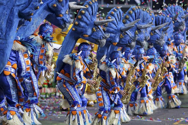 Members of the Woodland String Band perform during the 116th annual Mummers Parade in Philadelphia on Friday, January 1, 2016. Outrageously costumed Mummers strutted their stuff Friday at the city's annual New Year's Day parade, a colorful celebration that features string bands, comic brigades, elaborate floats and plenty of feathers and sequins. (Photo by Joseph Kaczmarek/AP Photo)