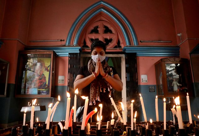 A worshipper wearing a protective face mask prays at a church during Good Friday, amidst the spread of the coronavirus disease (COVID-19), in Kolkata, India, April 2, 2021. (Photo by Rupak De Chowdhuri/Reuters)