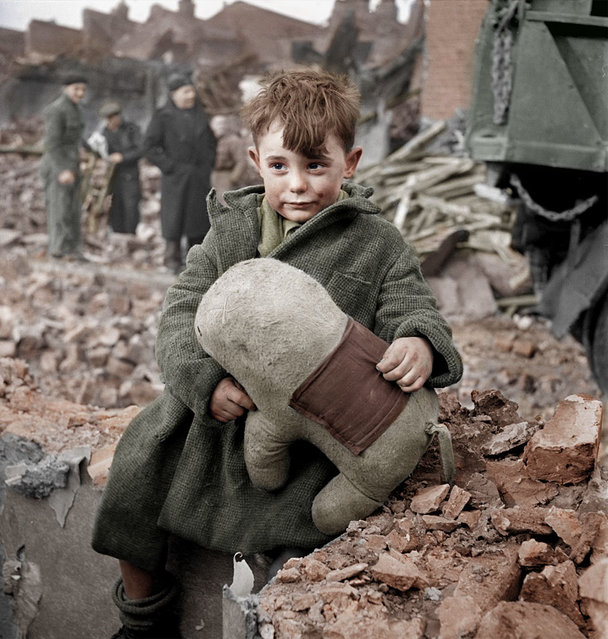 Abandoned boy holding a stuffed toy animal. London, 1945. Colorized by HansLucifer. (Photo by Toni Frissell)