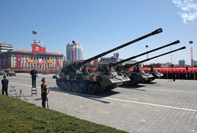 Tanks roll past during a parade for the 70th anniversary of North Korea's founding day in Pyongyang, North Korea, Sunday, September 9, 2018. North Korea staged a major military parade, huge rallies and will revive its iconic mass games on Sunday to mark its 70th anniversary as a nation. (Photo by Kin Cheung/AP Photo)