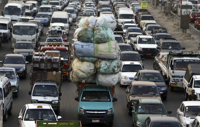 A traffic jam, one of five key issues Egyptian President Mohamed Mursi outlined in his Al Nhada (Renaissance) project, is pictured in old Cairo October 8, 2012, a day after his 100th day in power. (Photo by Amr Abdallah Dalsh/Reuters)