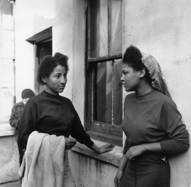 Two young women in Bute Town, one of the poorest areas of Cardiff, 23rd January 1954. The area has a lively ethnic mix of families with Arab, Somali, West African, West Indian, Egyptian, Greek and many other origins. (Photo by Bert Hardy/Picture Post/Getty Images)