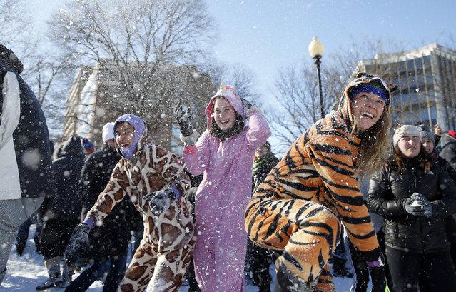 Young ladies wear animal onesie pajamas during an organized snowball fight at Dupont Circle Sunday, January 24, 2016 in Washington. (Photo by Alex Brandon/AP Photo)