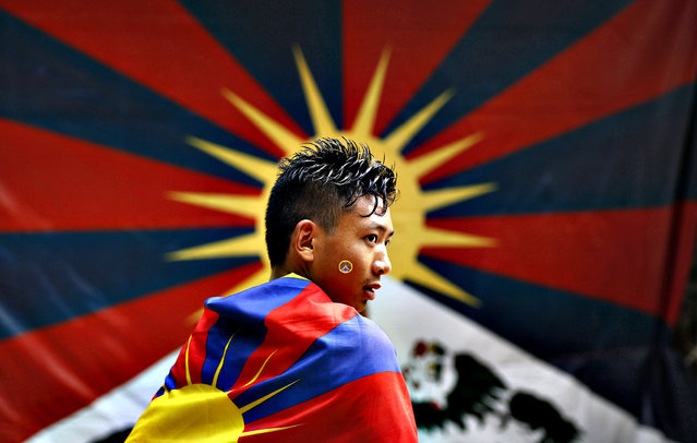 A Tibetan exile wears a Tibetan flag and participates in a protest rally in New Delhi, India, Wednesday, November 6, 2013. The rally was held to seek the attention of the international community towards the plight of Tibetans in Tibet and for the release of Tibetan political prisoners in China, among others, according to a press release. (Photo by Manish Swarup/AP Photo)