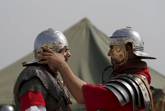Members of the Legio X Fretensis (Malta) re-enactment group prepare for a re-enactment of ancient Roman army life at Fort Rinella in Kalkara, outside Valletta, March 22, 2015. (Photo by Darrin Zammit Lupi/Reuters)