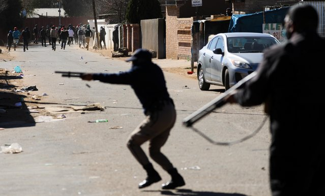 Police fire at protesters during unrest linked to the jailing of former President Jacob Zuma, in Soweto, Johannesburg, South Africa, July 13, 2021. (Photo by Sumaya Hisham/Reuters)