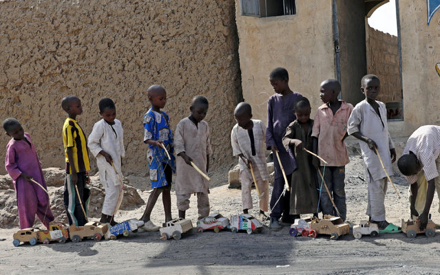 Boys play outside a bakery in Dapchi, in the northeastern state of Yobe, Nigeria March 22, 2018. (Photo by Afolabi Sotunde/Reuters)