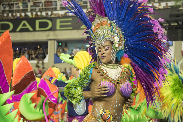 A performer dances during Uniao da Ilha performance at the Rio Carnival in Sambodromo on February 7, 2016 in Rio de Janeiro, Brazil. (Photo by Raphael Dias/Getty Images)