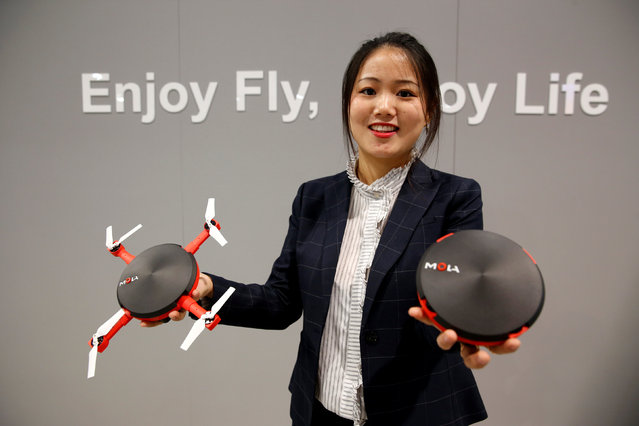 Eve Bu of Mola shows off the UFO, a drone that folds into a compact size for easy transport, during the 2017 CES in Las Vegas, Nevada, U.S., January 6, 2017. The drone is expected to be available in Spring 2017 and retail for $399.00, she said. (Photo by Steve Marcus/Reuters)