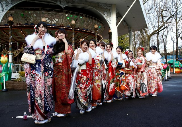 Japanese women wearing kimonos pose for their memorial photo after their Coming of Age Day celebration ceremony at an amusement park in Tokyo, Japan January 9, 2017. (Photo by Kim Kyung-Hoon/Reuters)