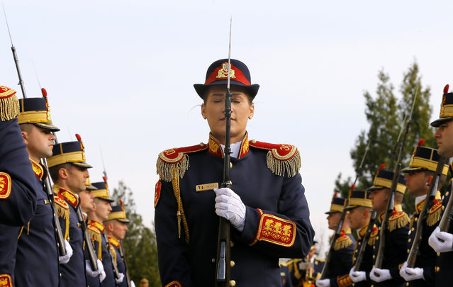 "A Romanian military woman, member of the 30th Guard Regiment ""Mihai Viteazul"" (Michael The Brave) Drill Team, performs during a military ceremony dedicated to the eleventh anniversary of the accession to NATO treaty, at the Romanian Defense Ministry headquarters in Bucharest, Romania, April 5, 2015. On 29 March 2004, Romania joined NATO alliance by depositing its instrument of ratification to the US State Department, becoming full member on 02 April 2004. (Photo by Robert Ghement/EPA)"