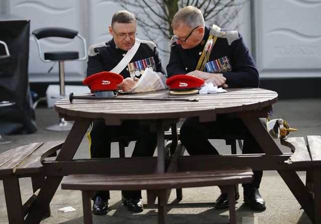 Horse Racing – Crabbie's Grand National Festival – Aintree Racecourse April 10, 2015: Service men read the form on ladies day during the Grand National. (Photo by Darren Staples/Reuters)