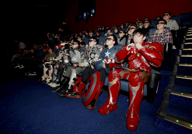 """A group of fans dressed in homemade replica armour of """"Avengers: Age of Ultron"""" movie characters, Iron Man, Captain America and Thor, watch the film in a theatre in Changchun, Jilin province, China on May 16, 2015. (Photo by Reuters/Stringer)"""