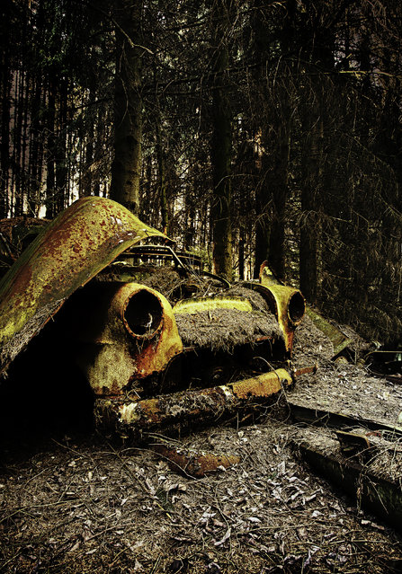 A rusty yellow car abandoned by Allied forces after the Second World War, in 2012, Belgium. (Photo by Dieter Klein/Barcroft Media)