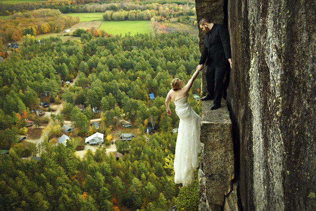 James and Melissa take a daring wedding photo. (Photo by Jay Philbrick/Caters News Agency)