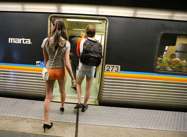 Katerina Marie and Kevin Coleman board MARTA for the No Pants Subway Ride 2014 joining other pantless riders invading MARTA at the Civic Center station on Sunday, January 12, 2014, in Atlanta. (Photo by Curtis Compton/Atlanta Journal & Constitution)