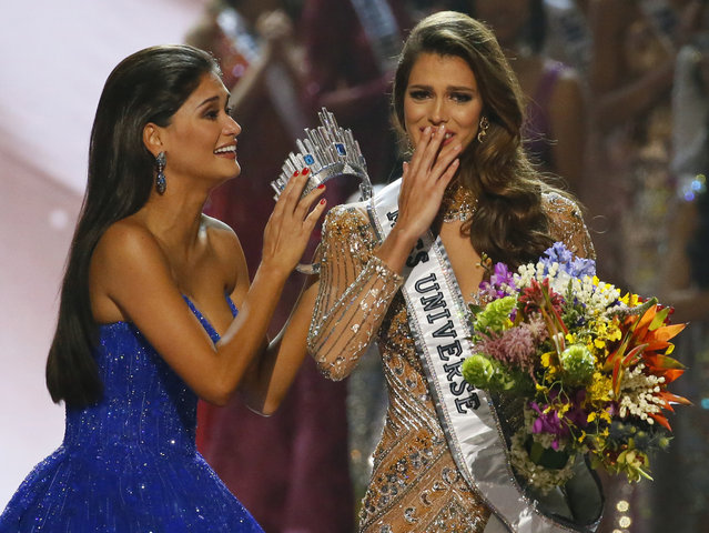 Miss Universe 2015 Pia Wurtzbach, left, prepares to crown Iris Mittenaere of France shortly after being proclaimed the Miss Universe 2016 in coronation Monday, January 30, 2017, at the Mall of Asia in suburban Pasay city, south of Manila, Philippines. (Photo by Bullit Marquez/AP Photo)